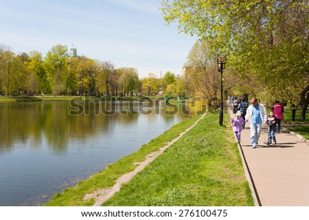 MOSCOW - MAY 07: People walking on the shore of the pond in Catherine Park on May 7, 2015 in Moscow. Catherine Park is located in Moscow's Meshchansky District. - stock photo