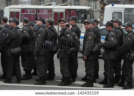 MOSCOW - MAY 6: Police detachment stands in the center of city near the protest manifestation of opposition, Bolotnaya square in Moscow, Russia on May, 6, 2013
