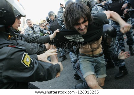 MOSCOW - MAY 6: Police detain participants of the demonstration against newly elected president Vladimir Putin on May 6, 2012 in Moscow, Russia. - stock photo