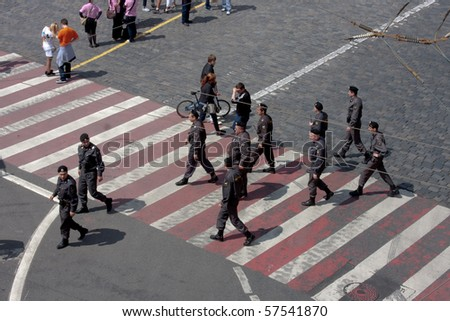 MOSCOW - MAY 29: Police officers follow the order on the march against breast cancer on MAY 29, 2010 in Moscow, Russia - stock photo