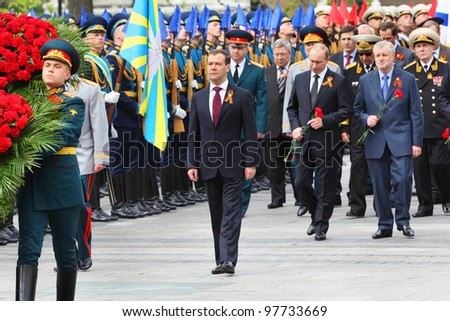 MOSCOW - MAY 8: President D.Medvedev, Prime minister V.Putin, veterans at ceremony of wreath laying at tomb of Unknown Soldier at Victory Day celebrations, May 8, 2011, Moscow, Russia.