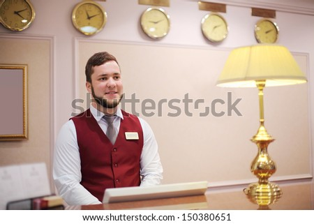 MOSCOW - MAY 22: Receptionist in red vest in Bogorodino hotel, on May 22, 2013 in Moscow, Russia. Four-star Borodino hotel located near Sokolniki Park and is modern building with elegant interiors. - stock photo
