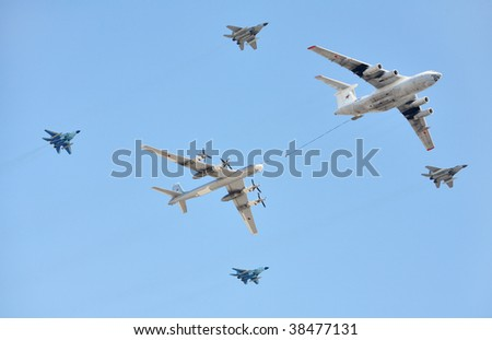 MOSCOW - MAY 9: Russian Air Force (four-engine aerial refueling tanker Il-76 and attack aircrafts Su-24 conducting aerial refueling) at Parade devoted to anniversary of Victory in the WW II held in Moscow, Russia on May 9, 2009.