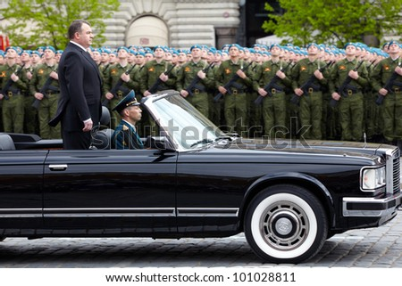 MOSCOW - MAY 9: Russian defense minister Anatoliy Serdyukov rides along rows of blue berets on 66-th Victory Day celebration on Red Square, May 9, 2011, Moscow, Russia. - stock photo