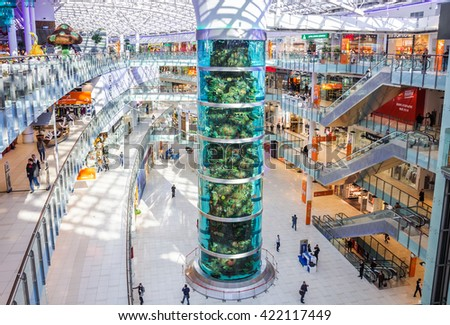 "MOSCOW - MAY 13, 2016: The tallest cylindrical aquarium in the world in the shopping center ""Aviapark"". ""Aviapark"" is one of the largest shopping and entertainment centres in Europe - stock photo"
