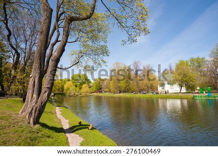 MOSCOW - MAY 07: Trees, pond and wooden pavilion in Catherine Park on May 7, 2015 in Moscow. Catherine Park is located in Moscow's Meshchansky District. - stock photo