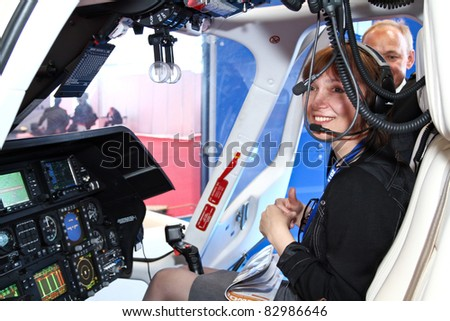 MOSCOW - MAY 19: Unidentified girl in a helicopter cockpit at the international exhibition of  the helicopter industry, HeliRussia on May 19, 2011 in Moscow