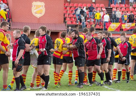 MOSCOW - MAY 13: Unidentified men in action on Russian Rugby Championship 2014 game Slava CSP (yellow) vs Metallurg (black), on May 13, 2014, in Moscow, Russia - stock photo