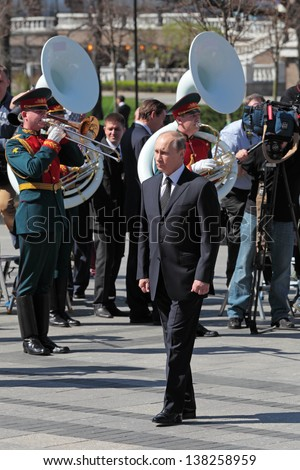 MOSCOW - MAY 8: Vladimir Putin at the ceremony of laying flowers to the Tomb of the Unknown Soldier. Festive events dedicated to the 67th Anniversary of Victory Day on MAY 8, 2013 in Moscow, Russia - stock photo
