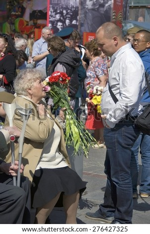MOSCOW - MAY 09, 2015: War veteran woman portrait. Victory Day celebration in Moscow.