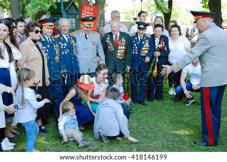 MOSCOW - MAY 09, 2016: War veterans pose for photos. Victory Day celebration in Gorky park in Moscow.