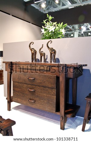 MOSCOW-MAY 18: Wooden chest of commode at the international exhibition of professional furniture EEM Euroexpofurniture on May 18, 2011 in Moscow - stock photo
