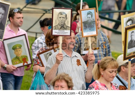MOSCOW - MAY 9: World War II veterans sit on the podium near the Kremlin Wall and watch the parade on Victory Day celebration  Russia. - stock photo
