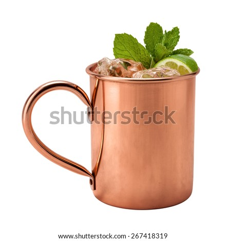 Moscow Mule in a Copper Mug. This is a Vodka drink served with mint, and a garnished with a wedge of lime, The image is a cut out, isolated on a white background, and includes a clipping path.  - stock photo