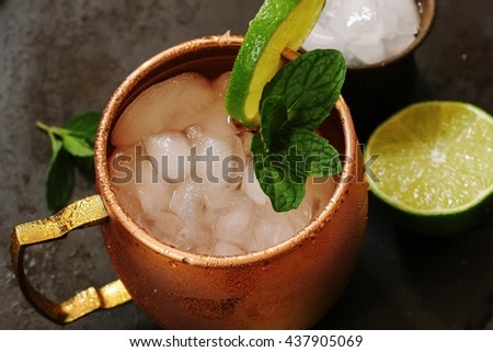 Moscow Mule in a copper mug - Vodka drink served with mint garnish and lime wedge, selective focus - stock photo