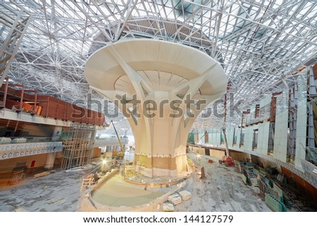 MOSCOW - NOV 29: Construction works at central prop of second phase of new terminal at Domodedovo Airport, November 29, 2012, Moscow, Russia. Terminal A has area of 96 thousand sq. m. - stock photo