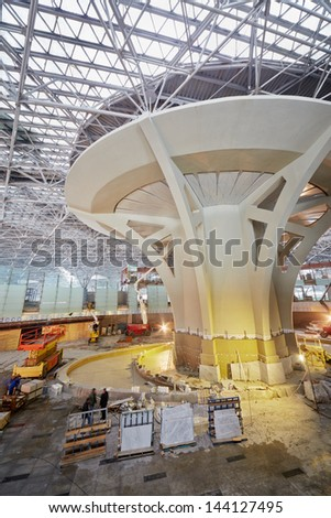 MOSCOW - NOV 29: Workers at construction of terminal  at Domodedovo Airport, November 29, 2012, Moscow, Russia. Domodedovo airport - one of six main airports in Moscow and Moscow region. - stock photo
