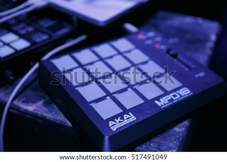 MOSCOW - 15 NOVEMBER,2016: Akai MPD pad controller for dj on stage.Professional beat maker equipment MPD.Play beats,push pad buttons on live performance