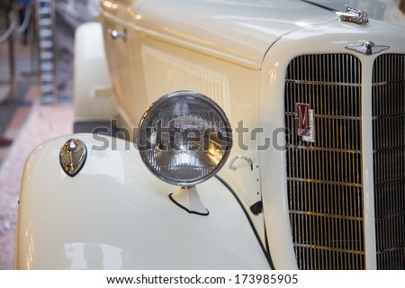 MOSCOW -NOVEMBER 21: GUM department store, November 21, 2013, Moscow, Russia.  Exhibition of vintage russian cars of all times - stock photo