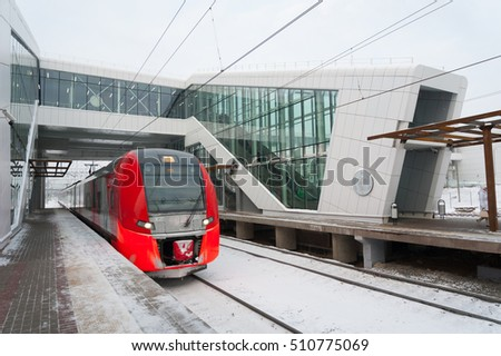 "MOSCOW - NOVEMBER 1: ""Lastochka"" train arriving to the ""Vladykino"" station on Moscow Central Circle (MCC) of November 1, 2016 in Moscow. MCC was opened to passengers on 10 September 2016."
