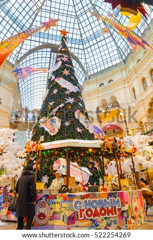 MOSCOW - NOVEMBER 22: New Year Fair with Christmas tree and decorations in the GUM on November 22, 2016 in Moscow. GUM is large shopping mall in the center of Moscow.