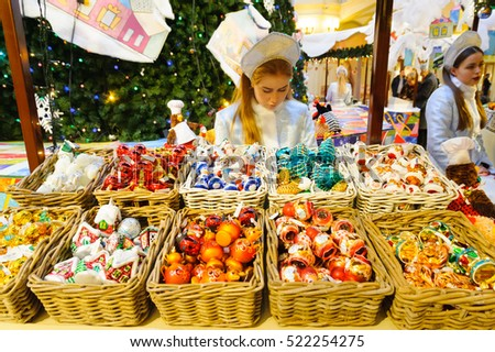 MOSCOW - NOVEMBER 22: Saleswoman behind the counter at the New Year Fair in GUM on November 22, 2016 in Moscow. GUM is large shopping mall in the center of Moscow.