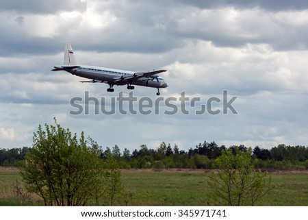 Moscow oblast, Russia - May 18, 2015: Russian turboprop airplane Ilyushin Il-20RT (Il-18) of the Russian NAVY landing at military airbase.