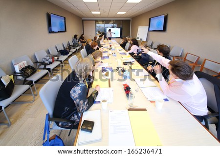 MOSCOW - OCT 10: Meeting in conference room at Otkritie Financial Corporation, on Oct 10, 2013 Moscow, Russia. It is full-service financial group offering retail, corporate, and institutional clients - stock photo