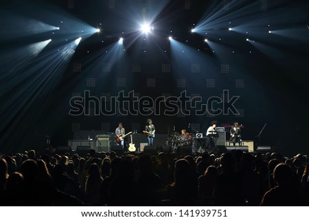 MOSCOW - OCT 12: Rock band performs in front of DAUGHTRY group on stage of Stadium Live on October 12, 2012 in Moscow, Russia. - stock photo