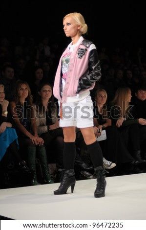 MOSCOW - OCTOBER 23: A model walks runway at the Blackstar Collection by by TIMATI & Andrei Ponomarev for S/S 2012 during MBFW on October 23, 2011 in Moscow, Russia