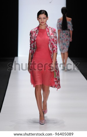 MOSCOW - OCTOBER 22: A Model walks runway at the Nikolay Krasnikov Collection for Spring/ Summer 2012 during Mercedes-Benz Fashion Week on October 22, 2011 in Moscow, Russia