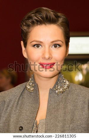 MOSCOW - OCTOBER, 8: Actress Mariya Kozhevnikova. Premiere of the movie Weekend, October, 8, 2014 at Octyabr Cinema in Moscow, Russia - stock photo