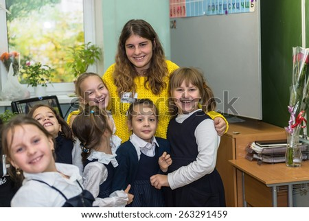 MOSCOW OCTOBER 3 - Alternate teacher Maria Pekanova with unidentified students of Junior class after the lesson. Teachers' Day in Moscow school October 3, 2014