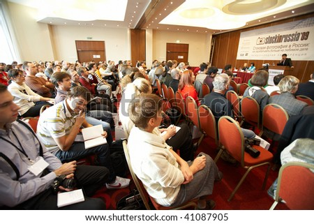 "MOSCOW - OCTOBER 2: Conference ""Stock in Russia 09"" on October 2, 2009 in Holiday Inn Lesnaya, Moscow, Russia. Side view of audience - stock photo"