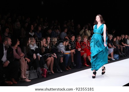 MOSCOW - OCTOBER 21: Editors and guests looking on runway show at the Von Vonni Collection for Spring/ Summer 2012 during Mercedes-Benz Fashion Week on October 21, 2011 in Moscow, Russia - stock photo