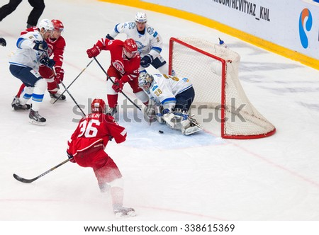 MOSCOW - OCTOBER 17, 2015: Egor Voronkov (59) attack Alexey Ivanov (28) during hockey game Vityaz vs Barys on Russia KHL championship on October 17, 2015, in Moscow, Russia. Vityaz won 4:3 - stock photo