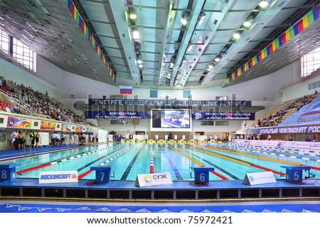 MOSCOW - OCTOBER 5: Four platforms in swimming championship 2010 in Olympic sporting complex on October 5, 2010 in Moscow, Russia. - stock photo