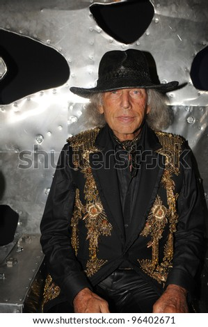 MOSCOW - OCTOBER 22: Hollywood party-goer James Goldstein (C) poses at the MHPI young designers presentation for Spring/ Summer 2012 during MBFW on October 22, 2011 in Moscow, Russia