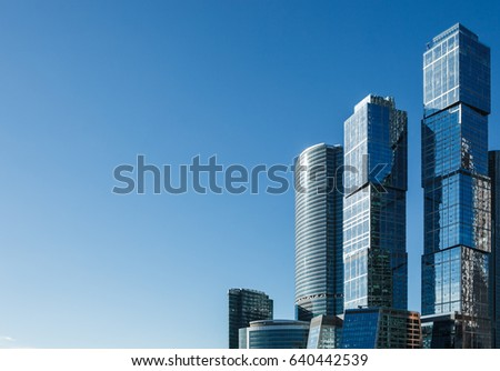 MOSCOW - 10 OCTOBER,2016 : International business and financial trade center Moscow City in Russian capital.Huge shiny skyscrapers under clean blue sky.Sunlight reflect on gigantic buildings