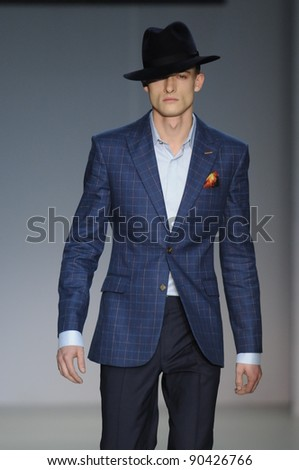 MOSCOW - OCTOBER 31: Model walks runway at the Arsenicum Collection for Spring/ Summer 2012 during Volvo Fashion Week on October 31, 2011 in Moscow, Russia - stock photo