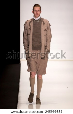MOSCOW - OCTOBER 22: Model walks runway at the Slava Zaitsev Collection for Spring/ Summer 2015 during Mercedes-Benz Fashion Week on October 22, 2014 in Moscow, Russia - stock photo