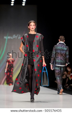 MOSCOW - OCTOBER 14: Model walks runway at the Slava Zaitsev Collection for Spring/ Summer 2017 during Mercedes-Benz Fashion Week on October 14, 2016 in Moscow, Russia