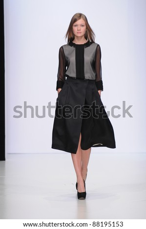 MOSCOW - OCTOBER 22: Model walks the runway at the Oleg Birykov Collection for Spring/ Summer 2012 during Mercedes-Benz Fashion Week on October 22, 2011 in Moscow, Russia
