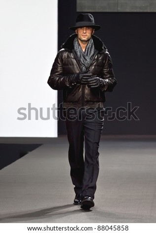 MOSCOW - OCTOBER 26: Model walks the runway during show of Stefano Ricci Collection as part of Fashion Week on October 26, 2011 in Moscow, Russia