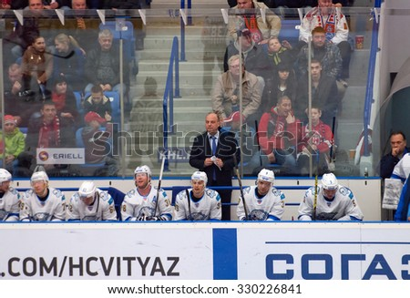 MOSCOW - OCTOBER 17, 2015: Pavel Bessonov, goalkeepers trainer, and Barys team during hockey game Vityaz vs Barys on Russia KHL championship on October 17, 2015, in Moscow, Russia. Vityaz won 4:3 - stock photo