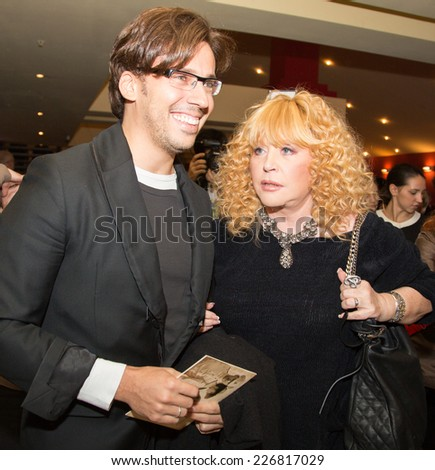 MOSCOW - OCTOBER,7 : Singer Alla Pugacheva and M. Galkin. Premiere of the movie Solnechny Udar, October, 7, 2014 at Octyabr Cinema in Moscow, Russia - stock photo