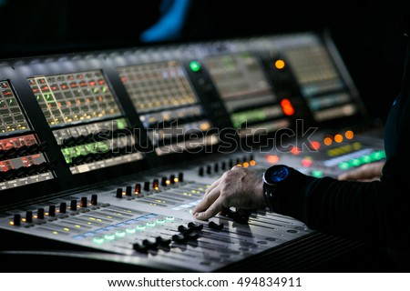 lighting technician. MOSCOW-6 OCTOBER,2016: Sound And Lights Technician Control The Music Show In Lighting