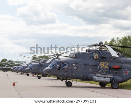 Moscow Region - June 17, 2015: Many gray military helicopters Russian Air Force on International Military-Technical Forum ARMY-2015 June 17, 2015, Moscow Region, Russia