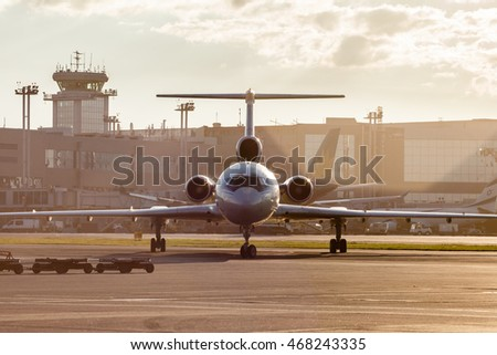 MOSCOW REGION, RUSSIA - JULY 21, 2016: Tupolev Tu-154M Belavia airlines taxiing before take off from Domodedovo International Airport in the evening.