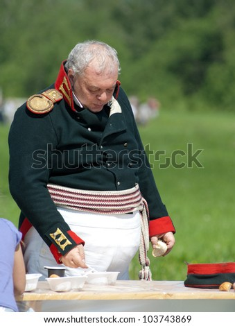MOSCOW REGION, RUSSIA - MAY 27: Unidentified man eat some food during 200 aunniversary re-enactment of the Borodino battle between Russian and French armies in 1812. May 27, 2012 in Borodino, Russia